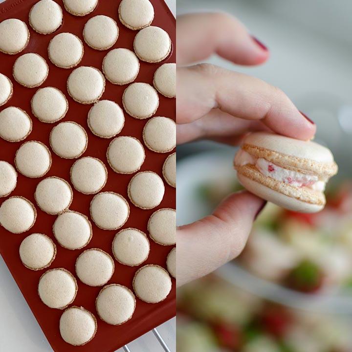 Färdiga macarons med jordgubbsfyllning