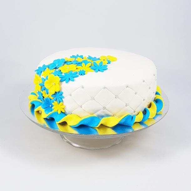 Gul och blå studenttårta.